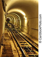 Tunnel with the train - The illuminated underground tunnel...
