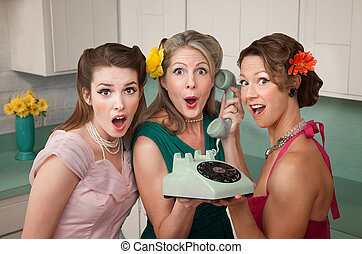 Shocked Women - Three surprised women holding a rotary...