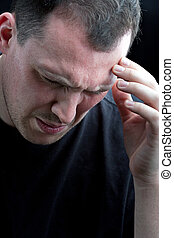 Man With Headache or Migraine Pain - A man with an intense...