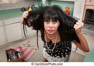 Woman Pulls Her Hair - Desperate housewife in a kitchen...