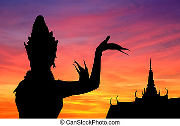 Thai dance sunset - Woman performing typical Thai dance....