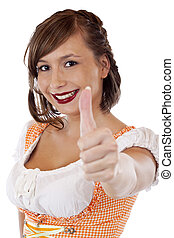 Young bavarian woman shows thumb up. Isolated on white...