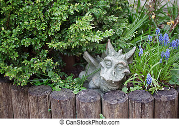 figure of a dragon in the green grass