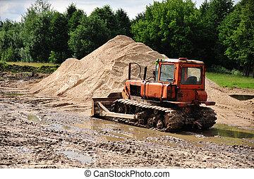 Bulldozer  works on platform for building