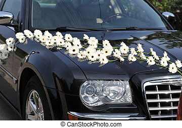 white flowers - dark car decorated with white flowers