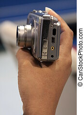 Womans Hand Holding Digital Camera - Close up of womans hand...