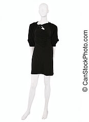 Little black dress and a cardigan dressed on a mannequin,...