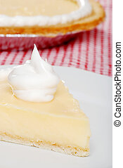 closeup slice of banana cream pie with more in the...
