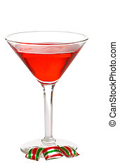 red martini with christmas candy - isolated red martini with...