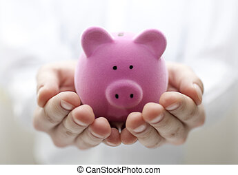 Man holding piggy bank Shallow DOF