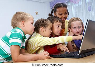 Little users - Portrait of smart schoolgirls and schoolboys...