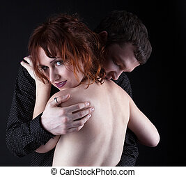 Young lovers in desire - Young man and red naked woman -...