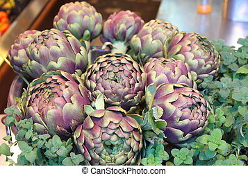 Artichokes - A composition of fresh artichokes. A typical...