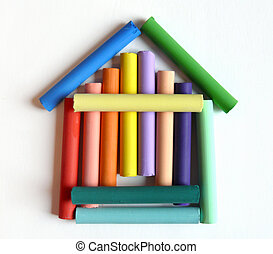 House Sweet home - toy house made of color pastels on white...