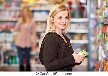 Young Woman Shopping - Portrait of a young woman smiling...