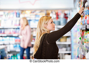 Young Woman Shopping - Young woman shopping in the...
