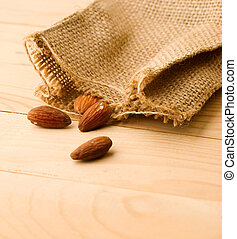 Almonds isolated on wooden background