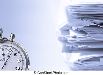 Stack of papers and stopwatch
