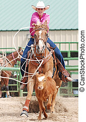 Cowgirl Roping Calf - Beautiful cowgirl riding a horse...