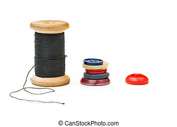 Thread bobbin and buttons isolated on white background