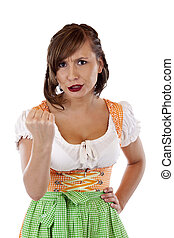 Beautiful woman with octoberfest dirndl clenches fist...