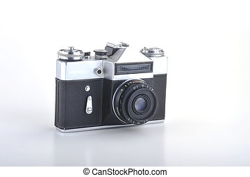 old retro camera on white