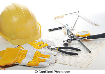 Yellow hardhat on drawings - Yellow hardhat, gloves and...