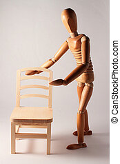 wooden dummy offering empty chair