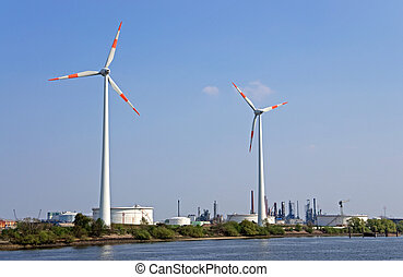 wind power and refinery - wind wheels and refinery in a...