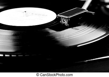 Vinyl disc - Vinyl record spinning on turntable close up