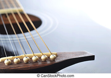 black guitar - Detail of an acoustic black guitar with the...