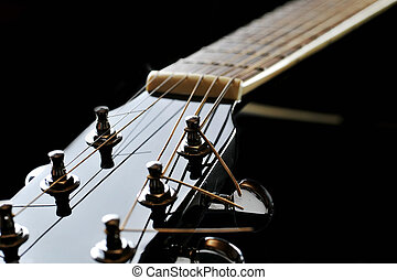neck of black guitar - Details of acoustic black guitar...