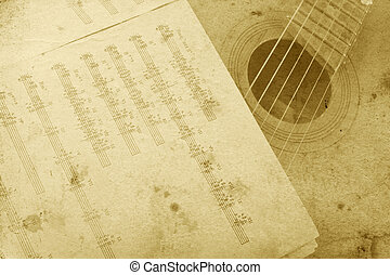 Old acoustic guitar and sheet music