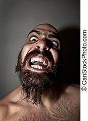 man with a terrifying expression - bearded man with...