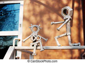 stylized figurines on the railing outdoor