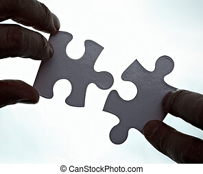 puzzle game solution teamwork - close up of a puzzle game...