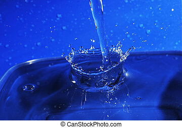 pouring water - Close-up of water in motion. pouring water