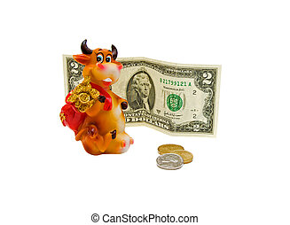 Toy cow, coins and banknotes $ 2 on a white background