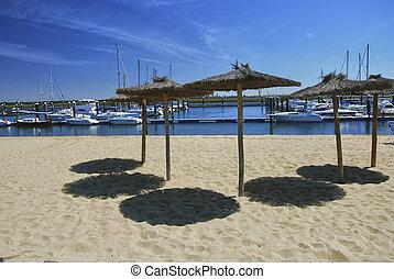 Umbrellas on the beach in Costa de la Luz, Andalusia, Spain