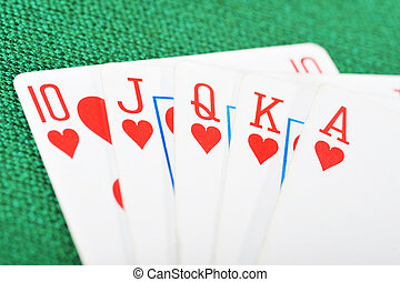 Poker winning hand over a vivid green background
