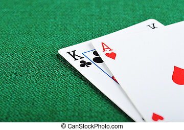 black jack on green - Ace of hearts and black jack on green