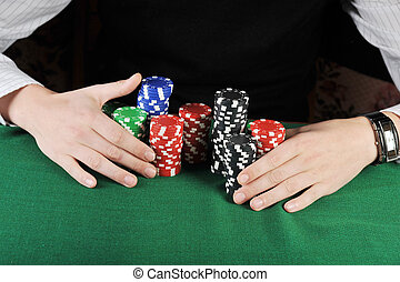 Card play - player is grabbing gambling chips that he won on...