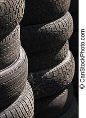 Rows of stacked tyres