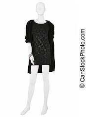 Mannequin dressed in black little dress and a cardigan,...