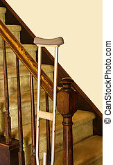 At Home Support - Crutch leans against bannister of stairs...