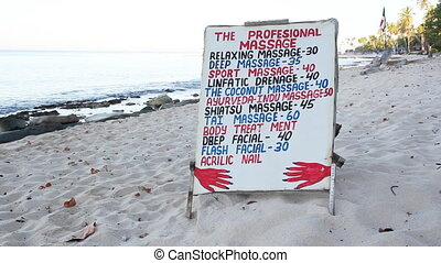Beach Massage options. - A sign showing different massage...