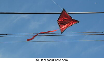 Kite stuck in wires. 2 shots. - A red kit stuck in overhead...