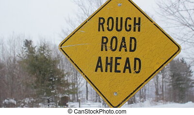 Rough road ahead - Yellow, diamond shaped sign warns of...