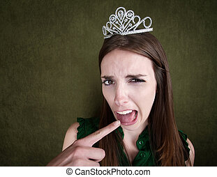 Young Queen Makes a Gagging Gesture