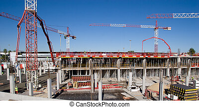 Construction Site - Construction site with cranes and blue...